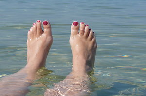 Home. Feet in the sea